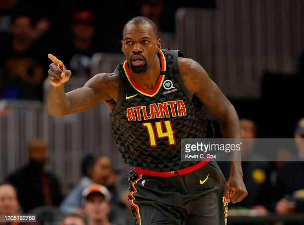 Dewayne Dedmon of the Atlanta Hawks reacts after dunking against the New York Knicks in the first half at State Farm Arena on February 09 2020 in...