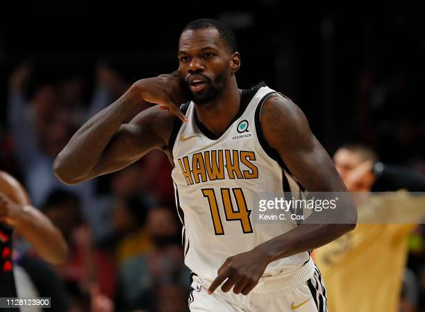 Dewayne Dedmon of the Atlanta Hawks reacts after hitting a threepoint basket against the Toronto Raptors at State Farm Arena on February 07 2019 in...