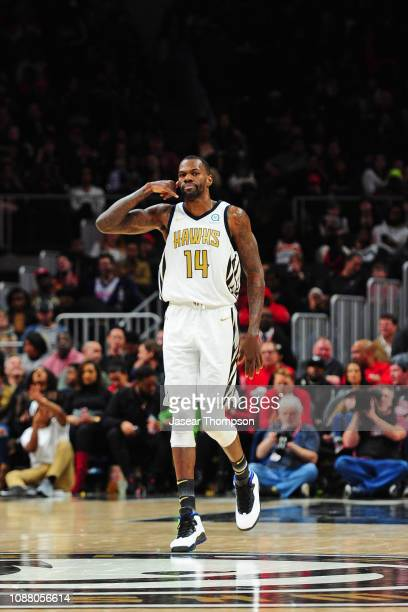 Dewayne Dedmon of the Atlanta Hawks reacts to a play during the game against the Orlando Magic on January 21 2019 at State Farm Arena in Atlanta...