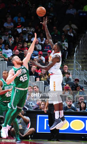 Dewayne Dedmon of the Atlanta Hawks shoots the ball against Aron Baynes of the Boston Celtics on November 6 2017 at Philips Arena in Atlanta Georgia...