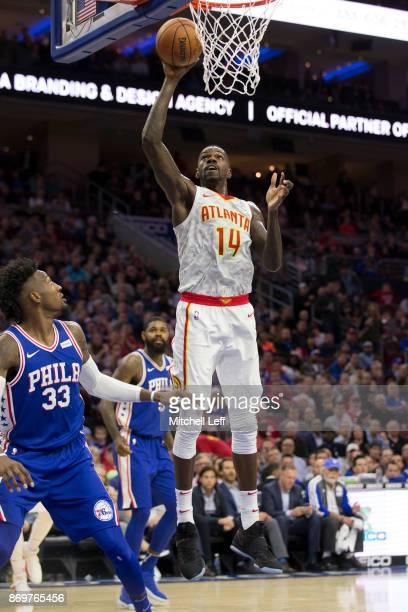 Dewayne Dedmon of the Atlanta Hawks shoots the ball against Robert Covington of the Philadelphia 76ers at the Wells Fargo Center on November 1 2017...