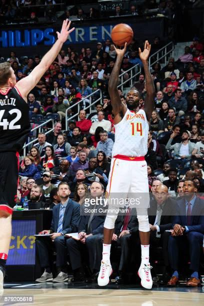Dewayne Dedmon of the Atlanta Hawks shoots the ball against the Toronto Raptors on November 25 2017 at Philips Arena in Atlanta Georgia NOTE TO USER...