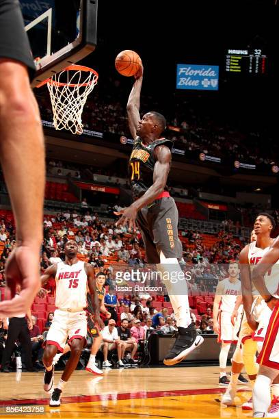 Dewayne Dedmon of the Atlanta Hawks shoots the ball during the preseason game against the Miami Heat on October 1 2017 at American Airlines Arena in...
