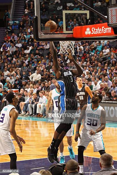 Dewayne Dedmon of the Orlando Magic drives to the basket against the Charlotte Hornets at the Time Warner Cable Arena on April 13 2016 in Charlotte...