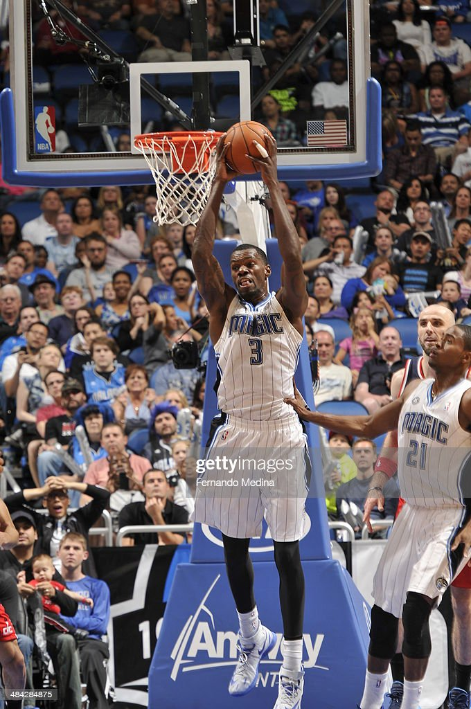 Dewayne Dedmon #3 of the Orlando Magic grabs the ball against the Washington Wizards during the game on April 11, 2014 at Amway Center in Orlando, Florida.