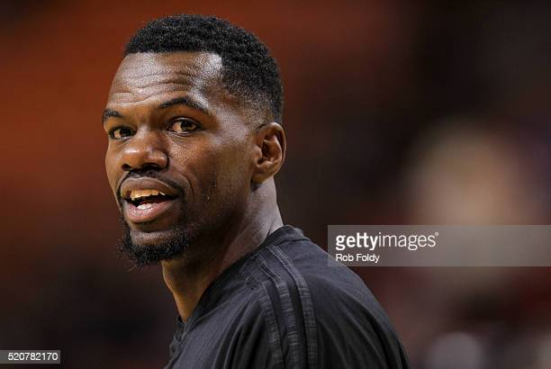 Dewayne Dedmon of the Orlando Magic looks on before the game against the Miami Heat at the American Airlines Arena on April 10 2016 in Miami Florida...