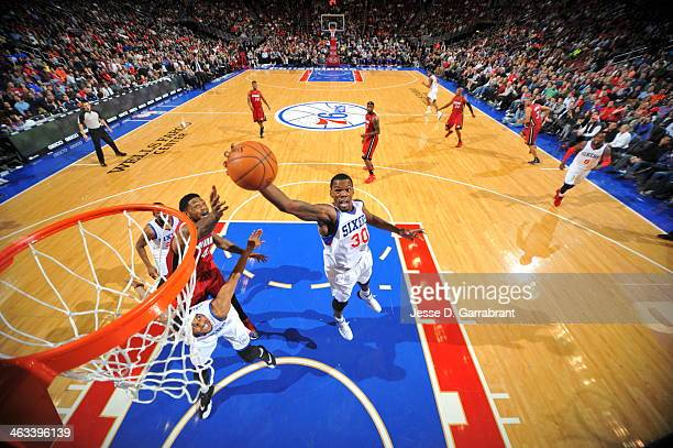 Dewayne Dedmon of the Philadelphia 76ers goes up for the layup against the Miami Heat at the Wells Fargo Center on January 17 2014 in Philadelphia...