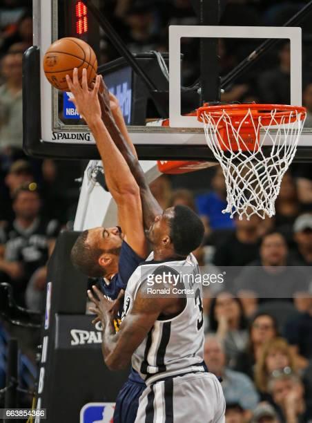 Dewayne Dedmon of the San Antonio Spurs blocks shot attempt of Rudy Gobert of the Utah Jazz at ATT Center on April 2 2017 in San Antonio Texas NOTE...