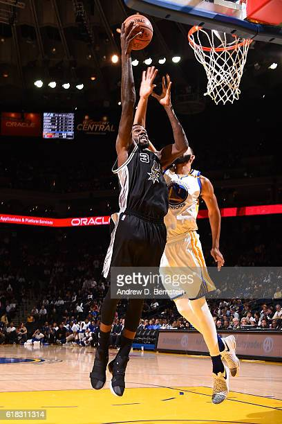 Dewayne Dedmon of the San Antonio Spurs drives to the basket against Golden State Warriors on October 25 2016 at ORACLE Arena in Oakland California...