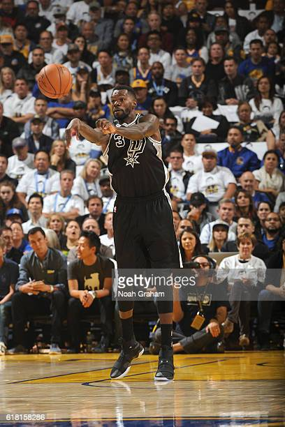 Dewayne Dedmon of the San Antonio Spurs passed the ball against the Golden State Warriors during a game on October 25 2016 at ORACLE Arena in Oakland...