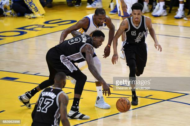 Dewayne Dedmon of the San Antonio Spurs reaches for a loose ball against Kevin Durant of the Golden State Warriors during Game Two of the NBA Western...