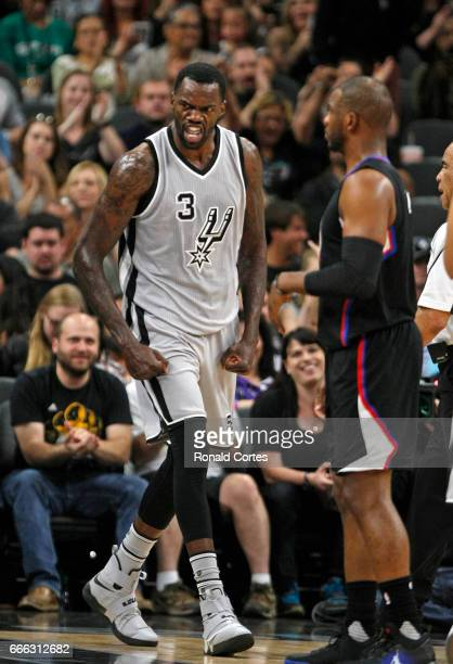 Dewayne Dedmon of the San Antonio Spurs reacts next to Chris Paul of the Los Angeles Clippers after a basket and a foul at ATT Center on April 8 2017...