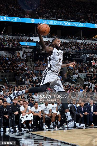 Dewayne Dedmon of the San Antonio Spurs saves the ball from going out of bounds against the New Orleans Pelicans on October 29 2016 at the ATT Center...