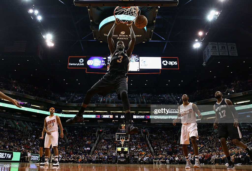 Dewayne Dedmon #3 of the San Antonio Spurs slam dunks the ball against the Phoenix Suns during the first half of the NBA game at Talking Stick Resort Arena on December 15, 2016 in Phoenix, Arizona.