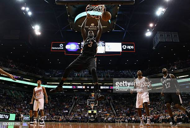 Dewayne Dedmon of the San Antonio Spurs slam dunks the ball against the Phoenix Suns during the first half of the NBA game at Talking Stick Resort...