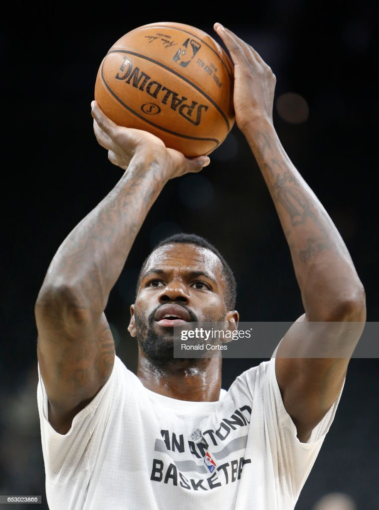 Dewayne Dedmon #3 of the San Antonio Spurs takes a practice shot before their game against the Atlanta Hawks at AT&T Center on March 13, 2017 in San Antonio, Texas.