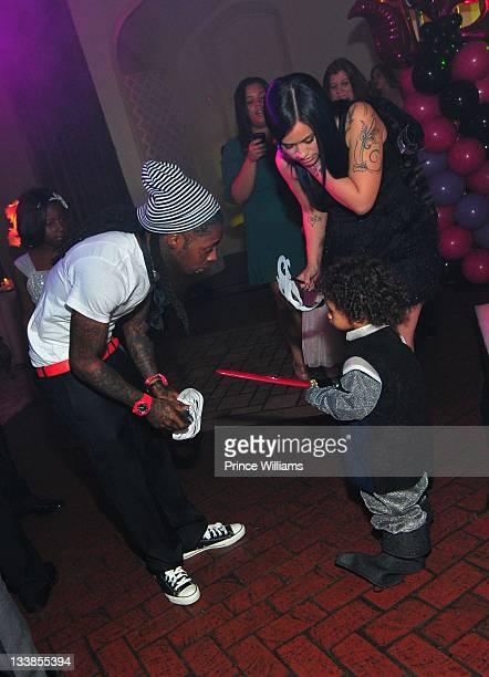 Dewayne Lil Wayne Carter and Dewayne Carter III attend Reginae Carter's 13th Birthday party at The Callanwolde Mansion on November 19 2011 in Atlanta...