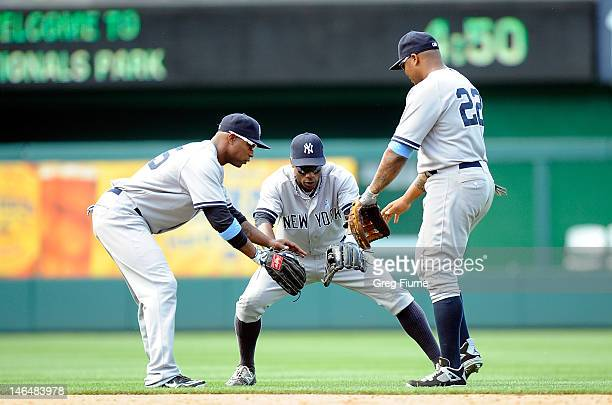 Dewayne Wise Curtis Granderson and Andruw Jones of the New York Yankees celebrate after a 41 victory against the Washington Nationals at Nationals...