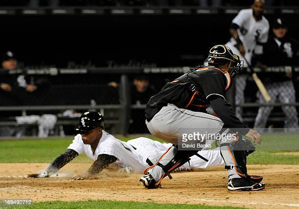 Dewayne Wise of the Chicago White Sox scores the gamewinning run as Rob Brantly of the Miami Marlins makes a late tag during the ninth inning on May...