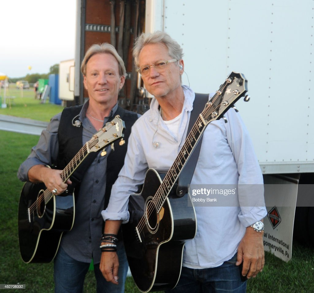 Dewey Bunnell and Gerry Beckley of America attend the 2014 Quick Chek New Jersey Festival of Ballooning at Solberg Airport on July 25, 2014 in Readington, New Jersey.
