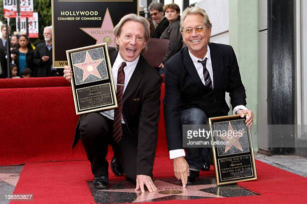 Dewey Bunnell and Gerry Beckley of the band America pose for photos as America is honored with a Star on the Hollywood Walk of Fame on February 6...