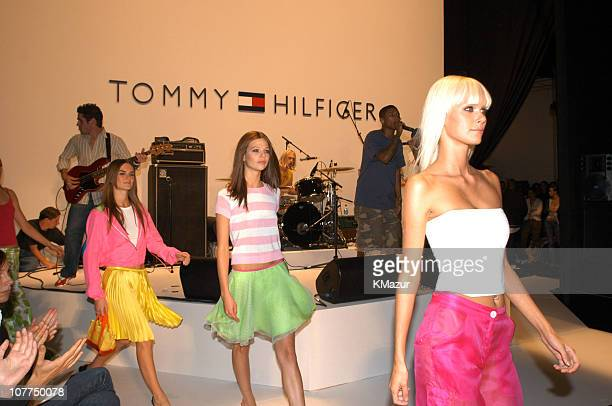 Dewi DriegenSusan Eldridge and Anouck Lepere wearing Tommy Hilfiger Spring 2004 with Pharrell Williams of NERD