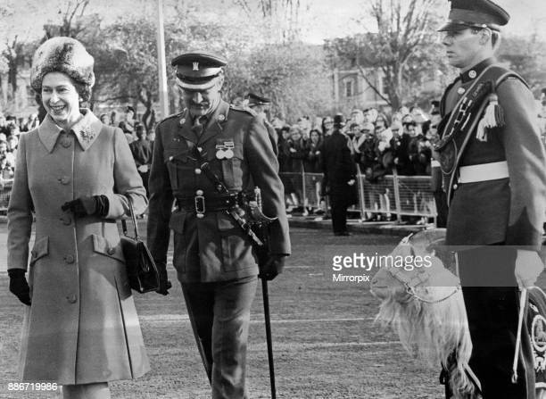 Dewi regimental mascot of the 3rd Battalion Royal Regiment of Wales is on his nest behaviour as Queen Elizabeth II completes her inpection...