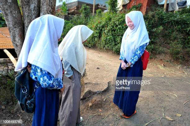 Dewi Resmana 13 years old while reading Qur'an and school together with his friend in Ciburuy town Garut West Java on July 262018 There are nine...