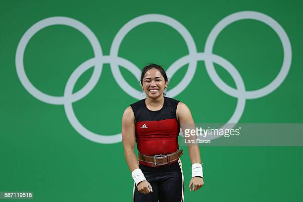 Dewi Safitri of Indonesia competes during the Women's 53kg Group A weightlifting contest on Day 2 of the Rio 2016 Olympic Games at Riocentro Pavilion...