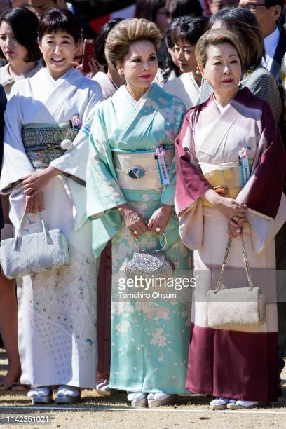 Dewi Sukarno attends the cherry blossom viewing party hosted by Japan's Prime Minister Shinzo Abe at the Shinjuku Gyoen National Garden on April 13...