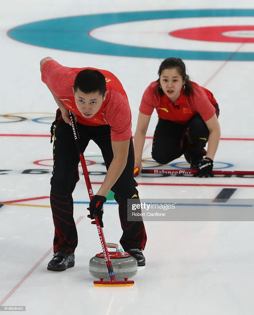 Dexin Ba and Rui Wang of China deliver a stone during the Curling Mixed Doubles Round Robin match ahead of the PyeongChang 2018 Winter Olympic Games at Gangneung Curling Centre on February 9, 2018 in Gangneung, South Korea.