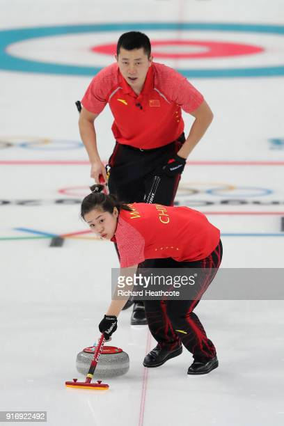 Dexin Ba and Rui Wang of China in action against Magnus Nedregotten and Kristin Skaslien of Norway during the Curling Mixed Doubles Tiebreaker on day...