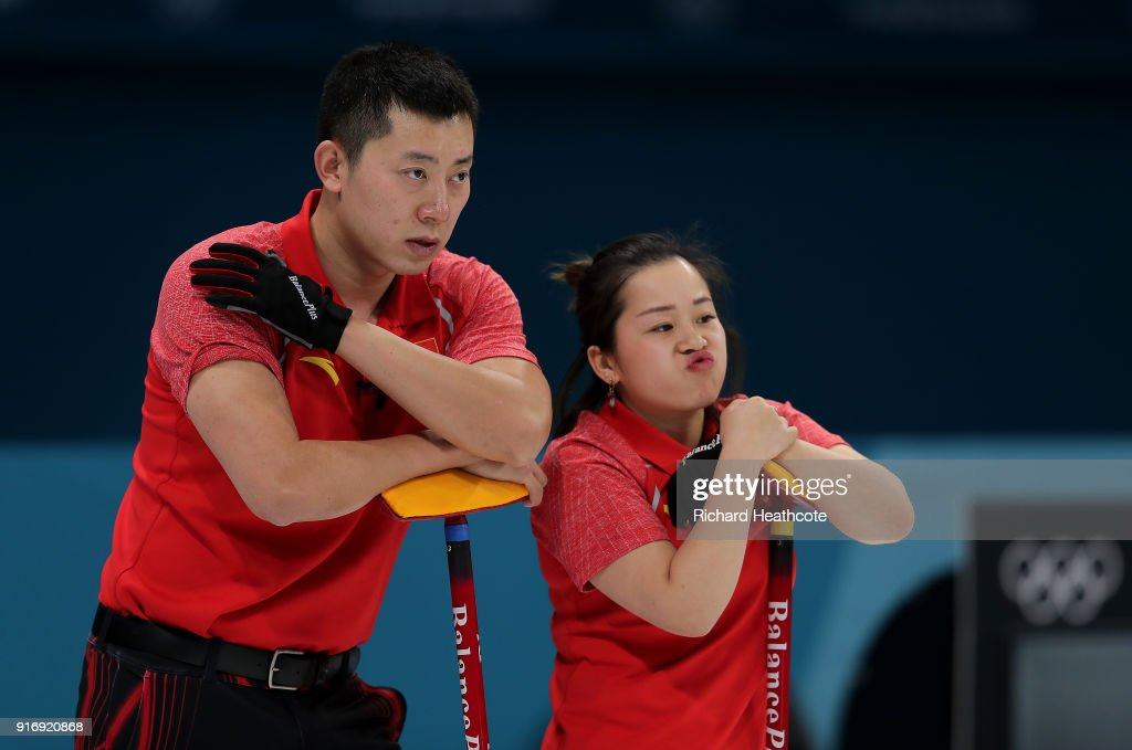 Dexin Ba and Rui Wang of China look on against Magnus Nedregotten and Kristin Skaslien of Norway during the Curling Mixed Doubles Tie-breaker on day two of the PyeongChang 2018 Winter Olympic Games at Gangneung Curling Centre on February 11, 2018 in Gangneung, South Korea.