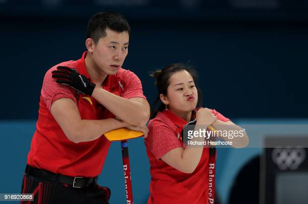 Dexin Ba and Rui Wang of China look on against Magnus Nedregotten and Kristin Skaslien of Norway during the Curling Mixed Doubles Tiebreaker on day...