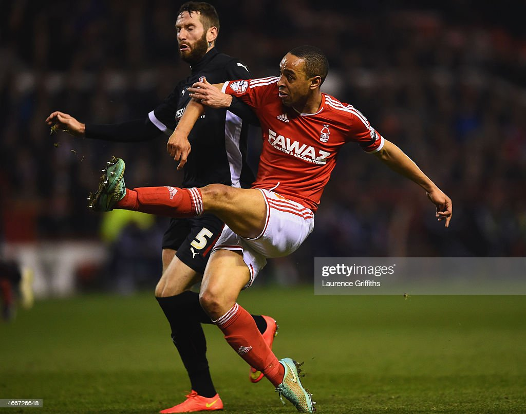 Dexter Blackstock of Nottingham Forest beats Kirk Broadfoot of Rotherham United to score their first goal during the Sky Bet Championship match between Nottingham Forest and Rotherham at City Ground on March 18, 2015 in Nottingham, England.