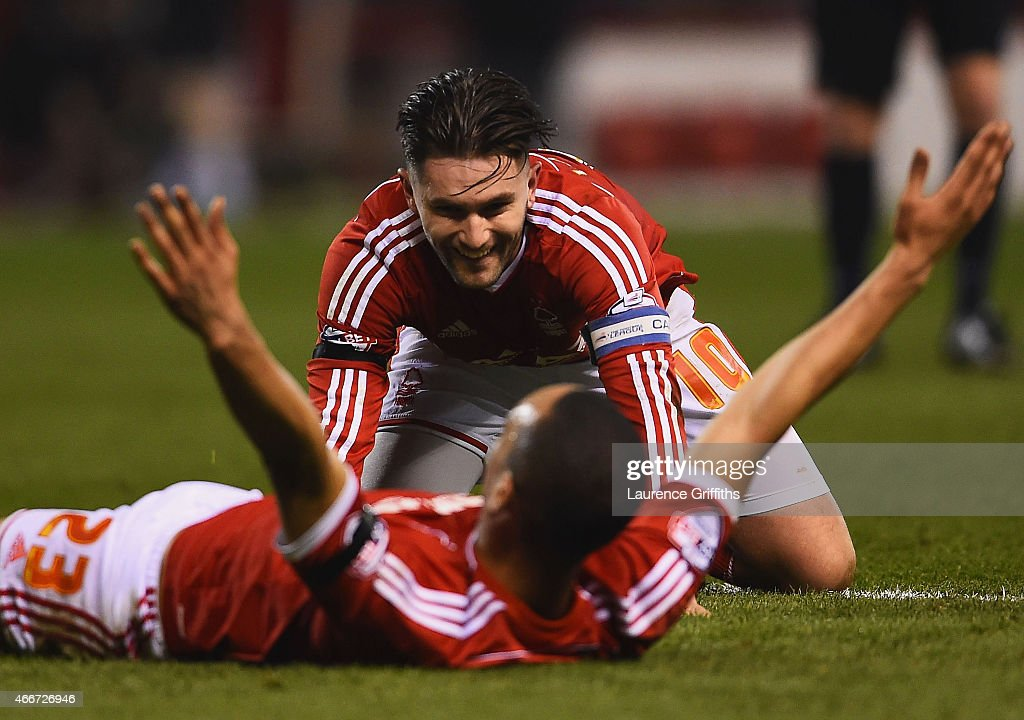 Dexter Blackstock of Nottingham Forest (23) celebrates with Henri Lansbury as he scores their first goal during the Sky Bet Championship match between Nottingham Forest and Rotherham at City Ground on March 18, 2015 in Nottingham, England.