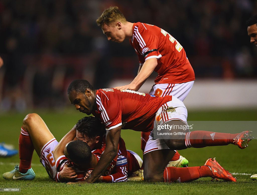 Dexter Blackstock of Nottingham Forest (23) celebrates with team mates as he scores their first goal during the Sky Bet Championship match between Nottingham Forest and Rotherham at City Ground on March 18, 2015 in Nottingham, England.