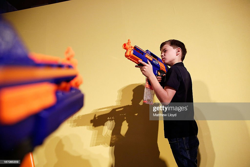 Dexter Cumberland, (8), poses with a Nerf N-Strike Elite Blaster at a media event at St Mary's Church in Marylebone on November 6, 2013 in London, England. The Toy Retailers Association's Dream Toys chart, is an independent list of the predicted Christmas top 12 best-selling gifts for children.