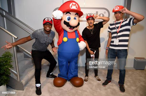 Dexter Darden Jordan Fisher and Kade Cannon visit the Nintendo booth at the 2017 E3 Gaming Convention at Los Angeles Convention Center on June 14...