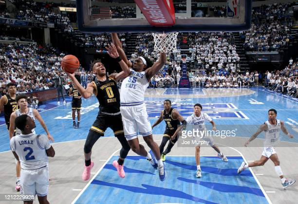 Dexter Dennis of the Wichita State Shockers drives to the basket for a layup against Precious Achiuwa of the Memphis Tigers during a game on March 5...
