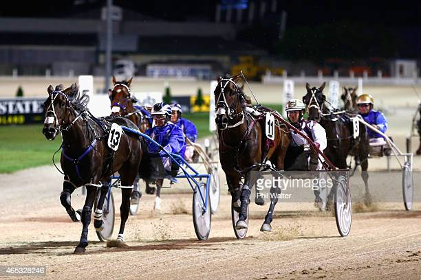 Dexter Dunn driving Christen Me wins the Auckland Cup ahead of Adore Me driven by Mark Purdon during the New Zealand Trotting Cup at Alexandra Park...