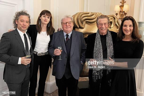Dexter Fletcher Amanda Berry Sir Alan Parker John Hurt and Barbara Broccoli attend a drinks reception awarding Sir Alan Parker the BAFTA Fellowship...