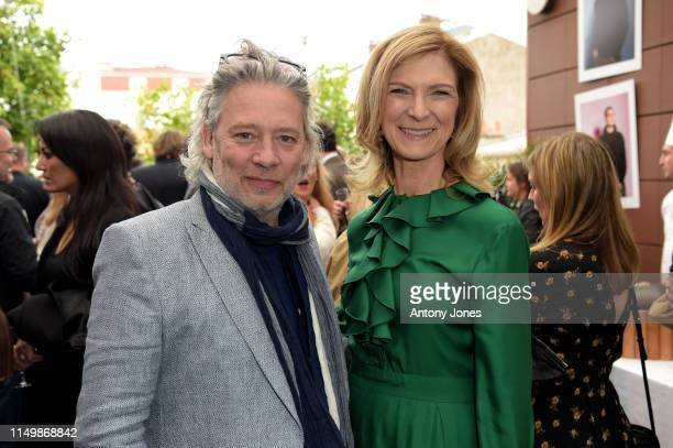 Dexter Fletcher and Dawn Hudson attend the Academy Member Soirée at the 72nd Cannes Film Festival on May 17 2019 in Cannes France