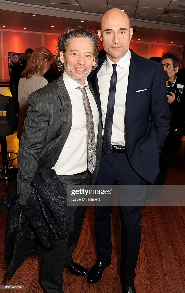 Dexter Fletcher (L) and Mark Strong attend the UK Premiere of 'Welcome To The Punch' at the Vue West End on March 5, 2013 in London, England.