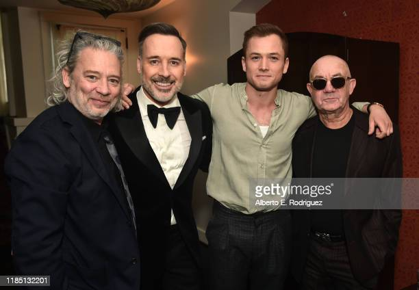 Dexter Fletcher, David Furnish, Taron Egerton and Bernie Taupin attend a Cocktail Reception in celebration of Rocketman at the Chateau Marmont on...