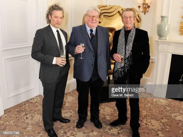Dexter Fletcher Sir Alan Parker and John Hurt attend a drinks reception awarding Sir Alan Parker the BAFTA Fellowship supported by Hackett at The...