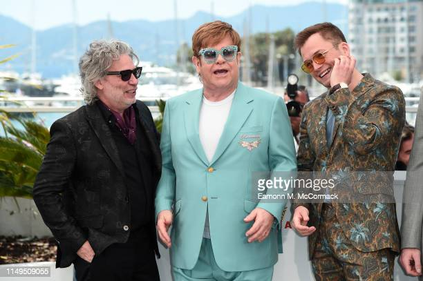 """Dexter Fletcher, Sir Elton John and Taron Egerton attend the photocall for """"Rocketman"""" during the 72nd annual Cannes Film Festival on May 16, 2019 in..."""