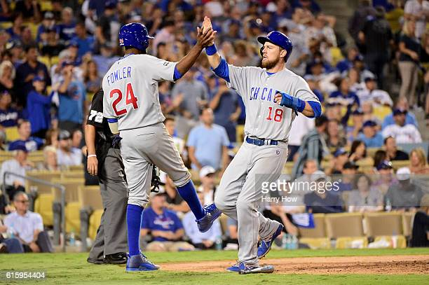 Dexter Fowler and Ben Zobrist of the Chicago Cubs celebrate after a threerun double in the eighth inning against the Los Angeles Dodgers in game five...