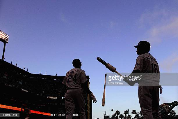 Dexter Fowler and Jonathan Herrera of the Colorado Rockies warm up before the start of the first inning of their game against the San Francisco...