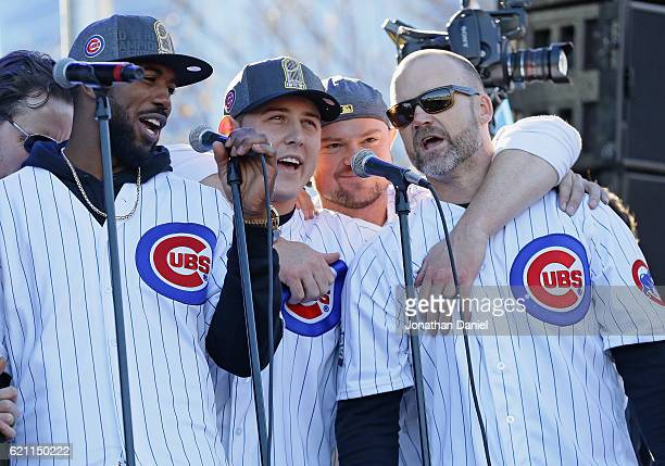 Dexter Fowler Anthony Rizzo Jon Lester and David Ross of the Chicago Cubs sing 'Go Cubs Go' during the Chicago Cubs victory celebration in Grant Park...